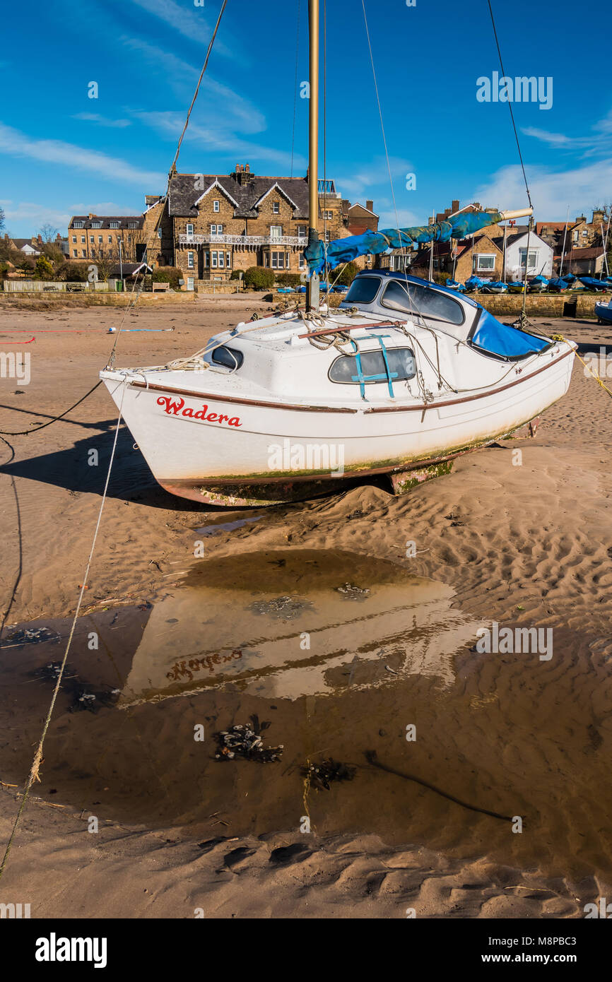 Motor Yacht Wadera moored in Alnmouth Harbour, Northumberland Coast AONB, UK at low tide, with copy space - Stock Image