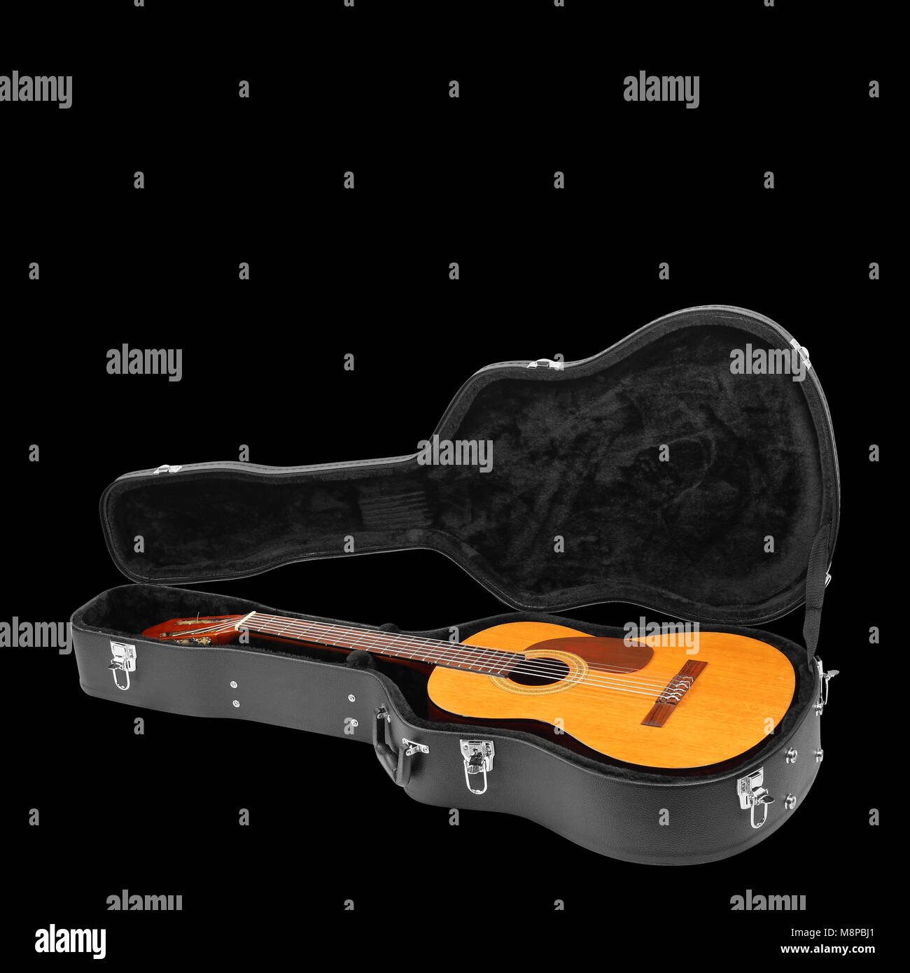 Musical instrument - Classic guitar hard case isolated on a black background. Stock Photo