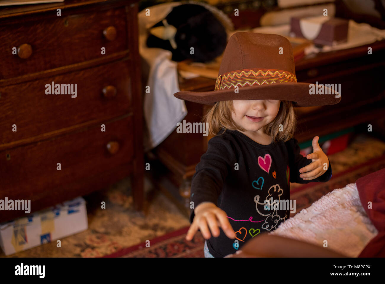 Little girl wearing a cowboy hat. - Stock Image