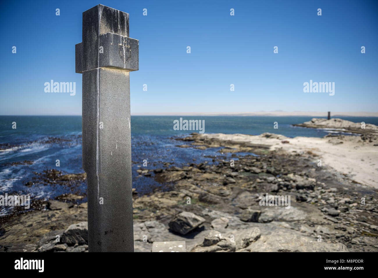 In 1488 Bartolomeu Dias raised a padrao to mark his voyage. In 1988 a new stone cross was erected after the original - Stock Image