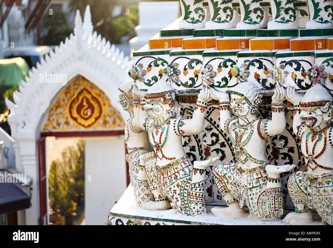 Stone statue of mythological creatures of Buddhist Temple Wat Arun in Bangkok, Thailand - Stock Image