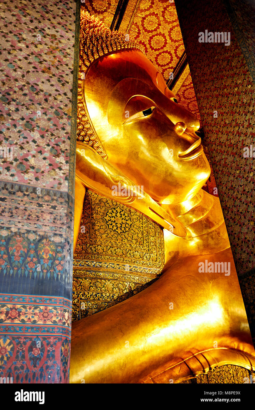 Famous Statue of Big Golden Buddha in wat Pho temple in Bangkok, Thailand - Stock Image