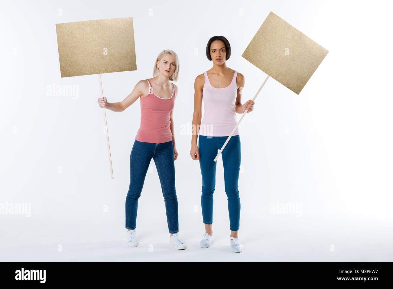 Nice pleasant women standing together - Stock Image