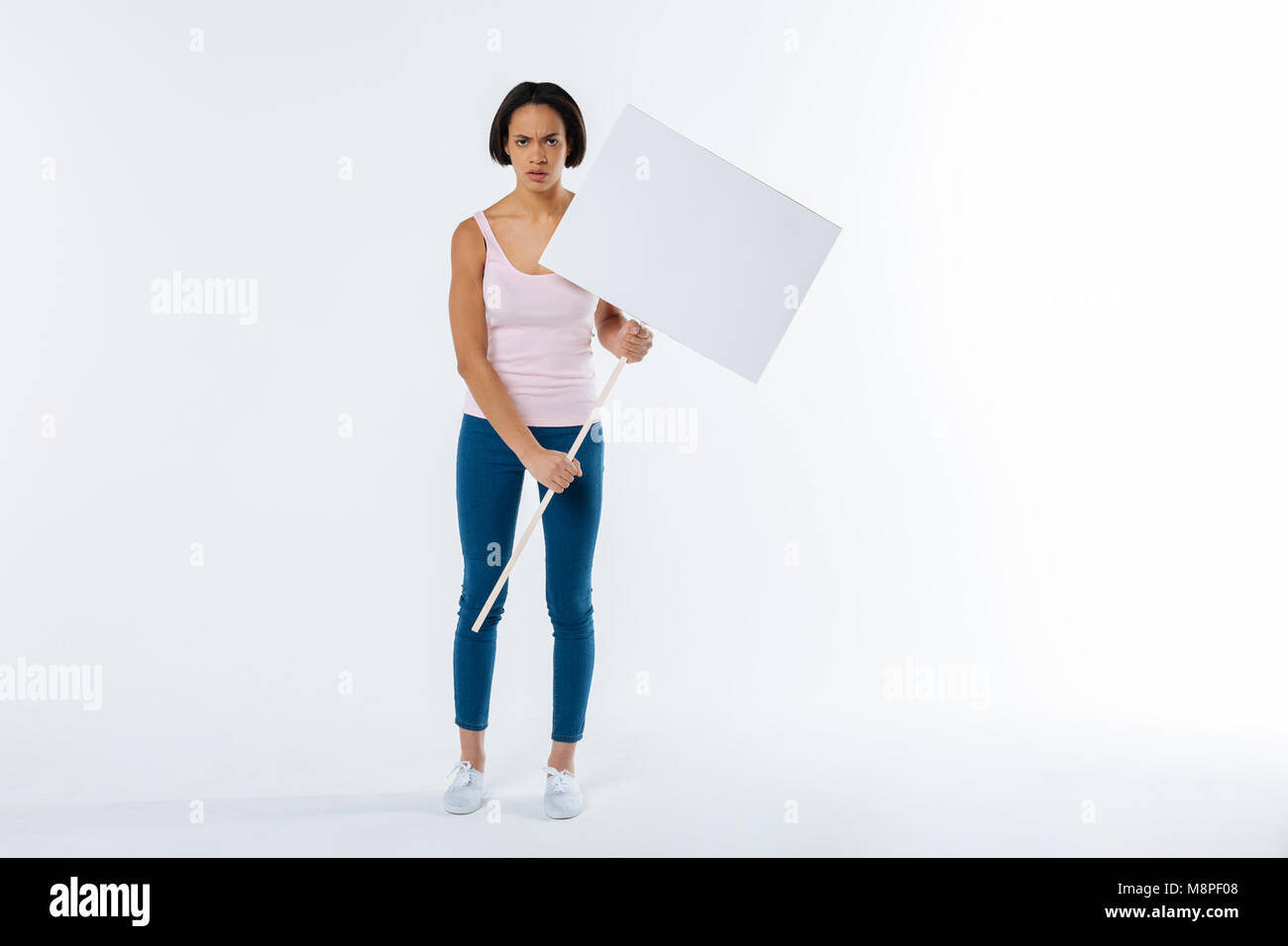 Cheerless unhappy woman raising social awareness - Stock Image