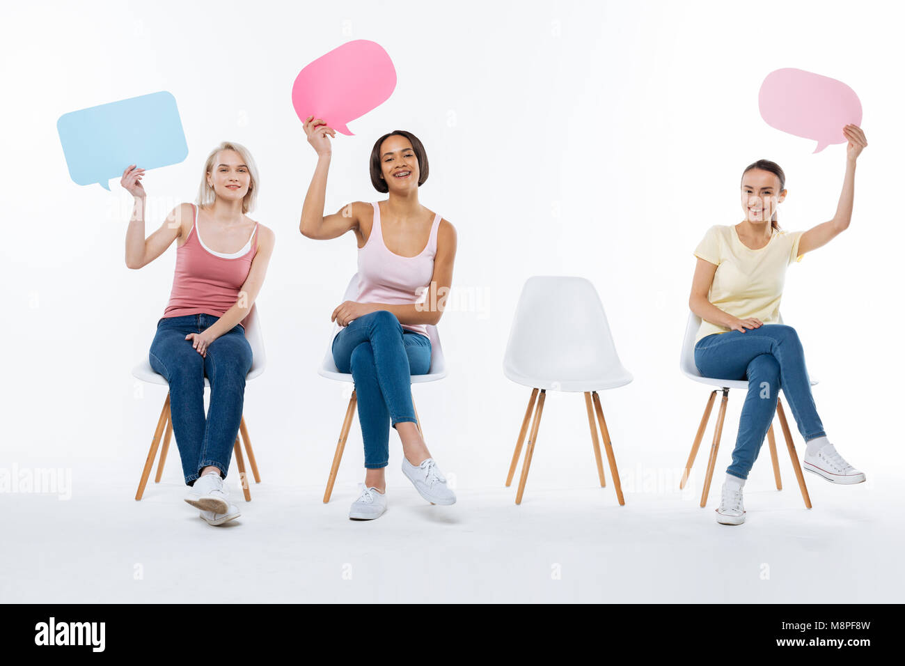 Delighted nice woman showing their signs - Stock Image
