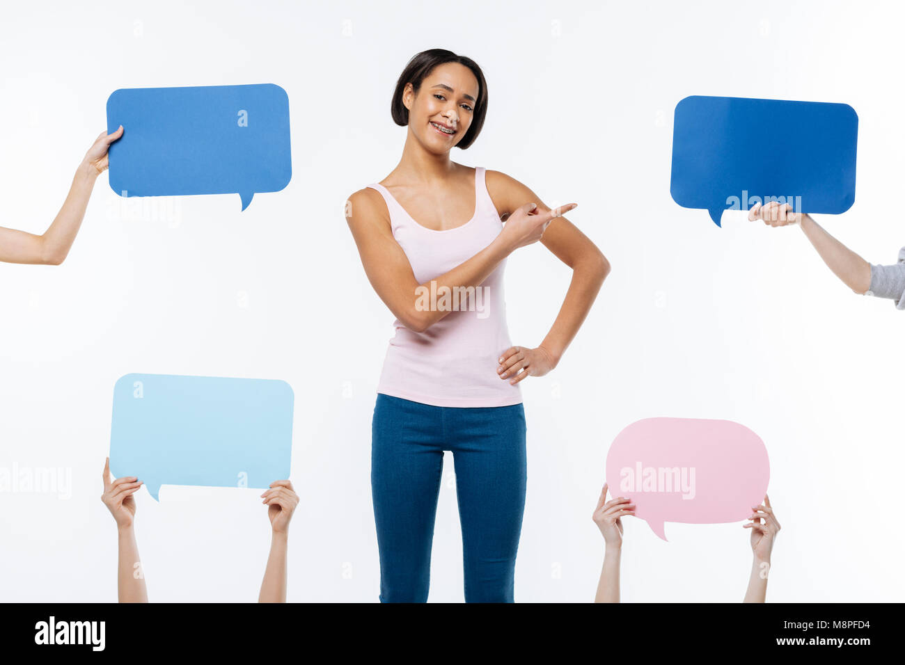 Cheerful positive woman showing her smile - Stock Image