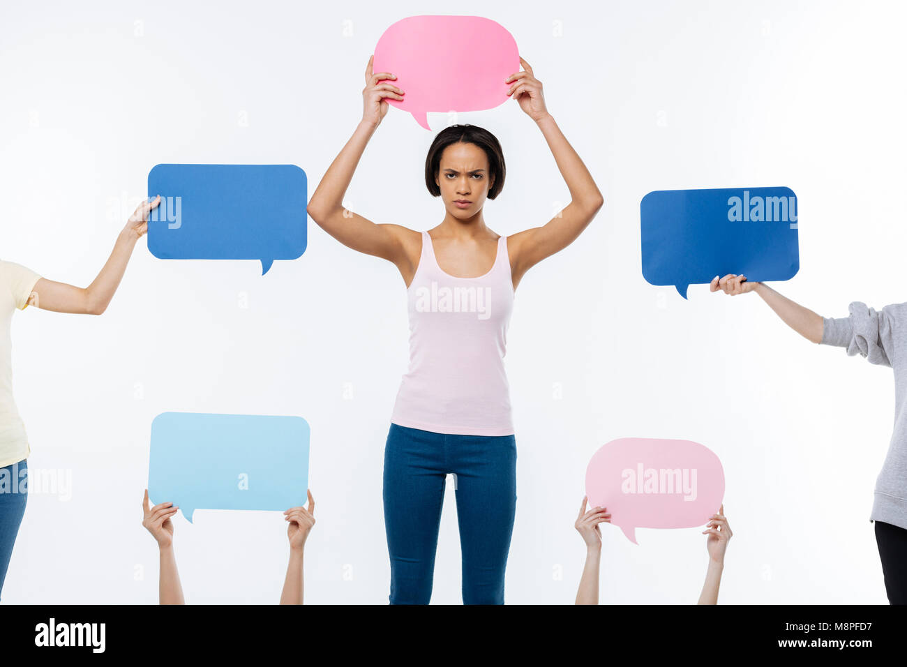 Smart nice woman holding an opinion sign - Stock Image