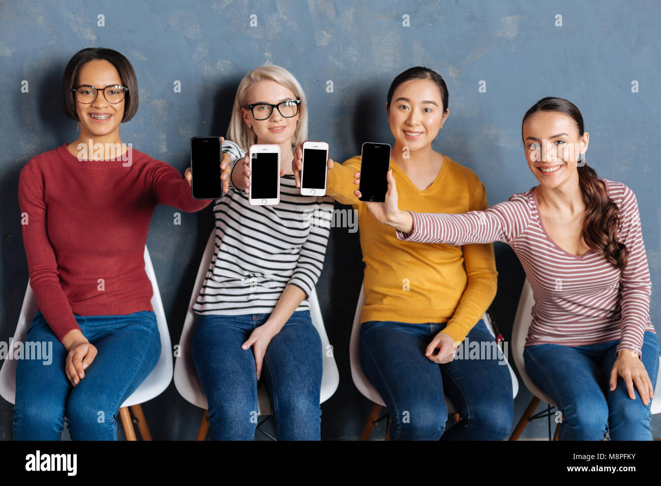 Close up of modern smartphones - Stock Image