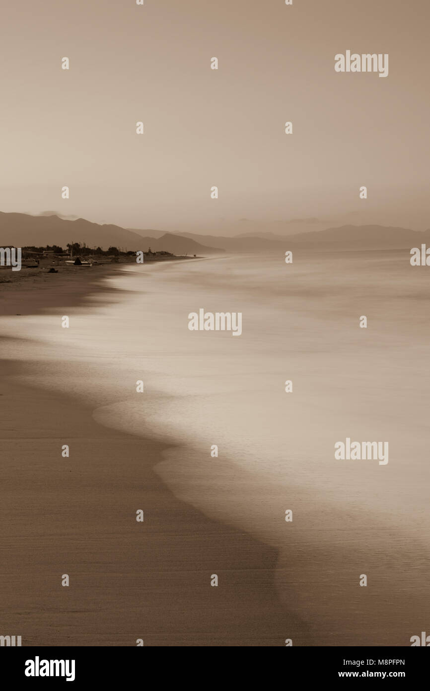 Sunrise by the beach sepia tones Stock Photo