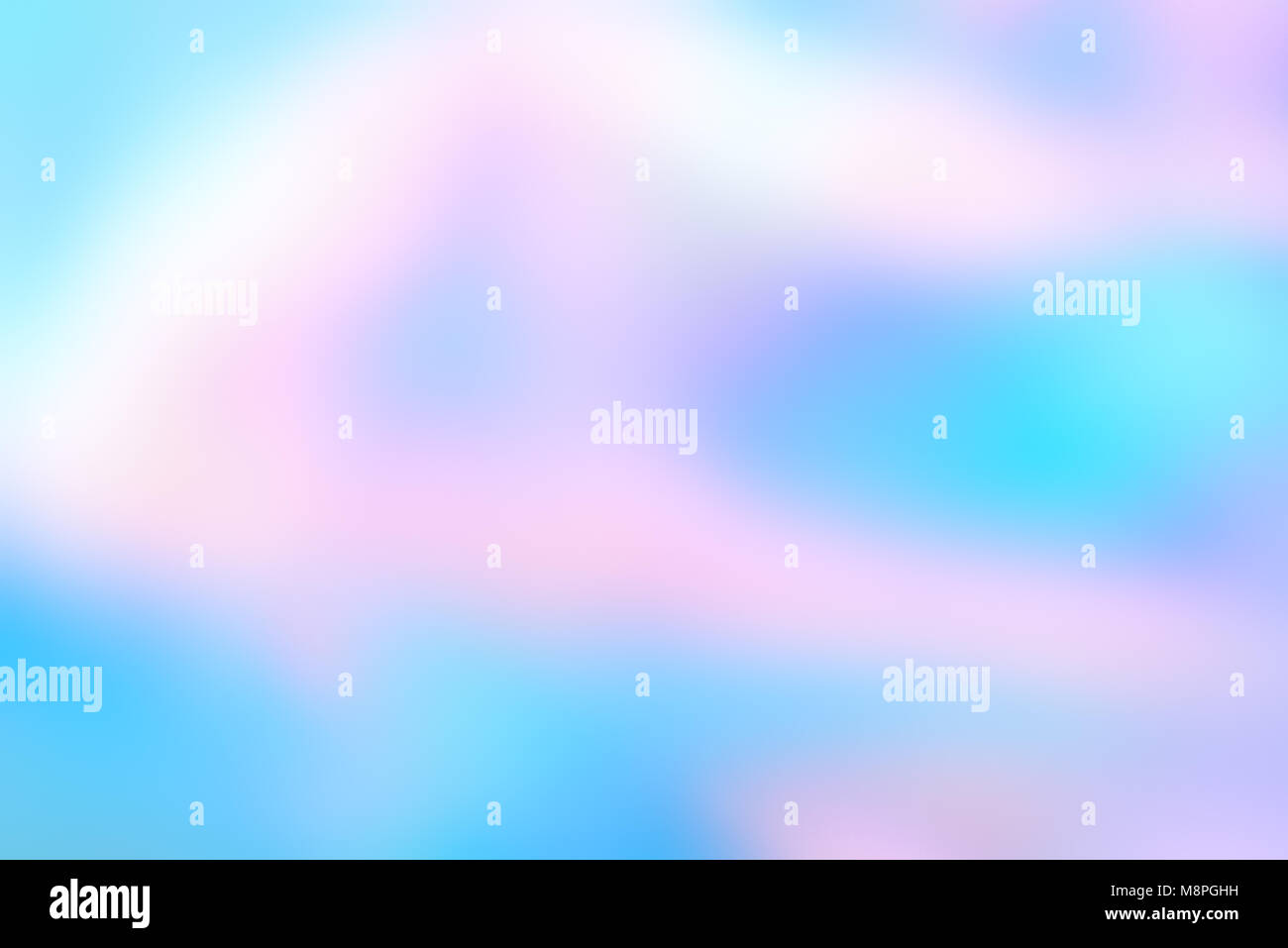 Abstract blurred holographic foil background in light colors. Wonderful magic background. Colorful wallpaper. Stock Photo