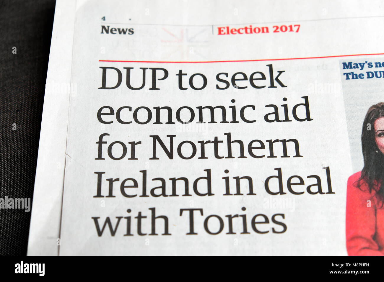 'DUP to seek economic aid for Northern Ireland in deal with Tories' Guardian newspaper election headline - Stock Image
