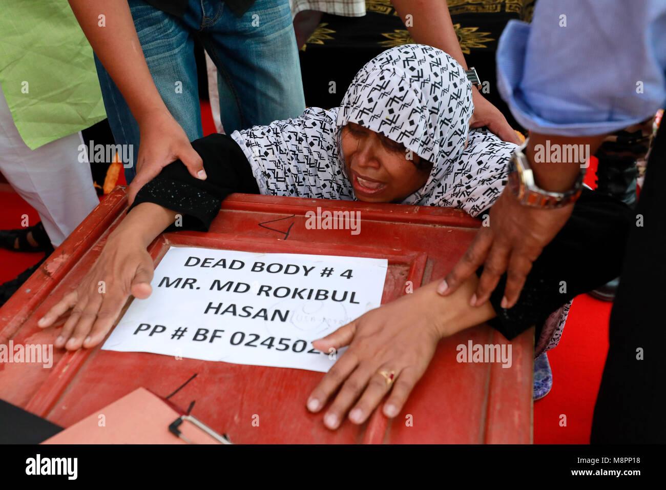 Dhaka, Bangladesh. 19th March, 2018.  Grief-stricken relatives of the US-Bangla plane crash victims at the Bangladesh Stock Photo