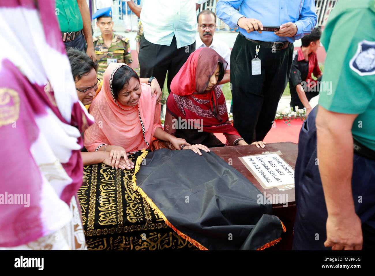 Dhaka, Bangladesh. 19th March, 2018.  Grief-stricken relatives of the US-Bangla plane crash victims at the Bangladesh Stock Photo