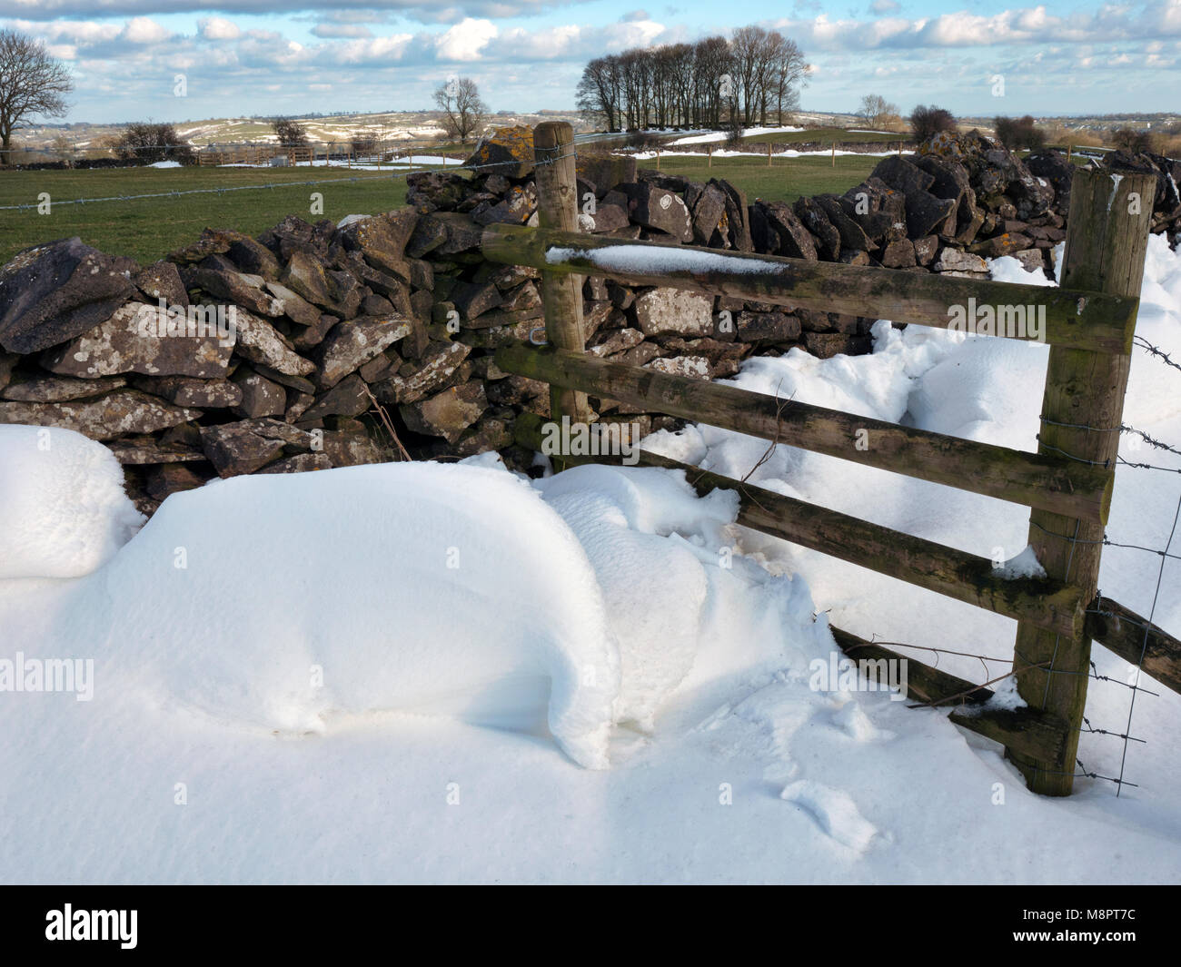 Tissington, Peak District National Park, Derbyshire, UK. 19th March, 2018. UK Weather: The last of the drifted snowStock Photo