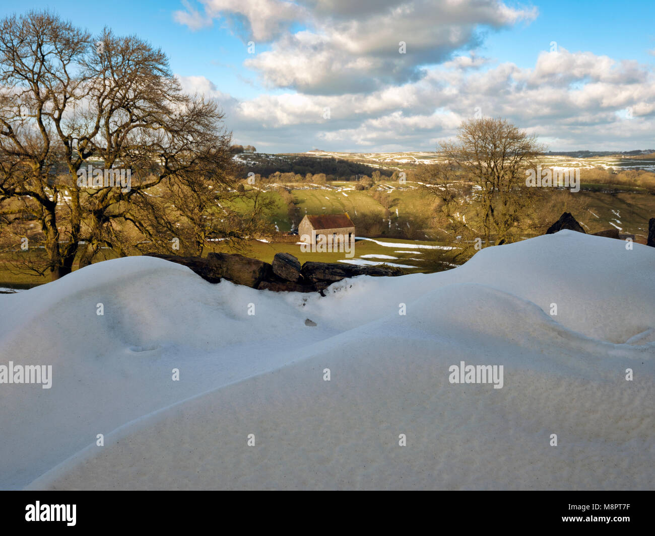 Tissington, Peak District National Park, Derbyshire, UK. 19th March, 2018. UK Weather: The last of the drifted snow Stock Photo