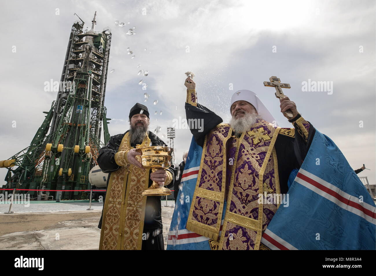 Kazakhstan. 20th Mar, 2018. KAZAKHSTAN - SEPTEMBER 11, 2017: An Orthodox priest conducts a blessing of a Soyuz-FG - Stock Image