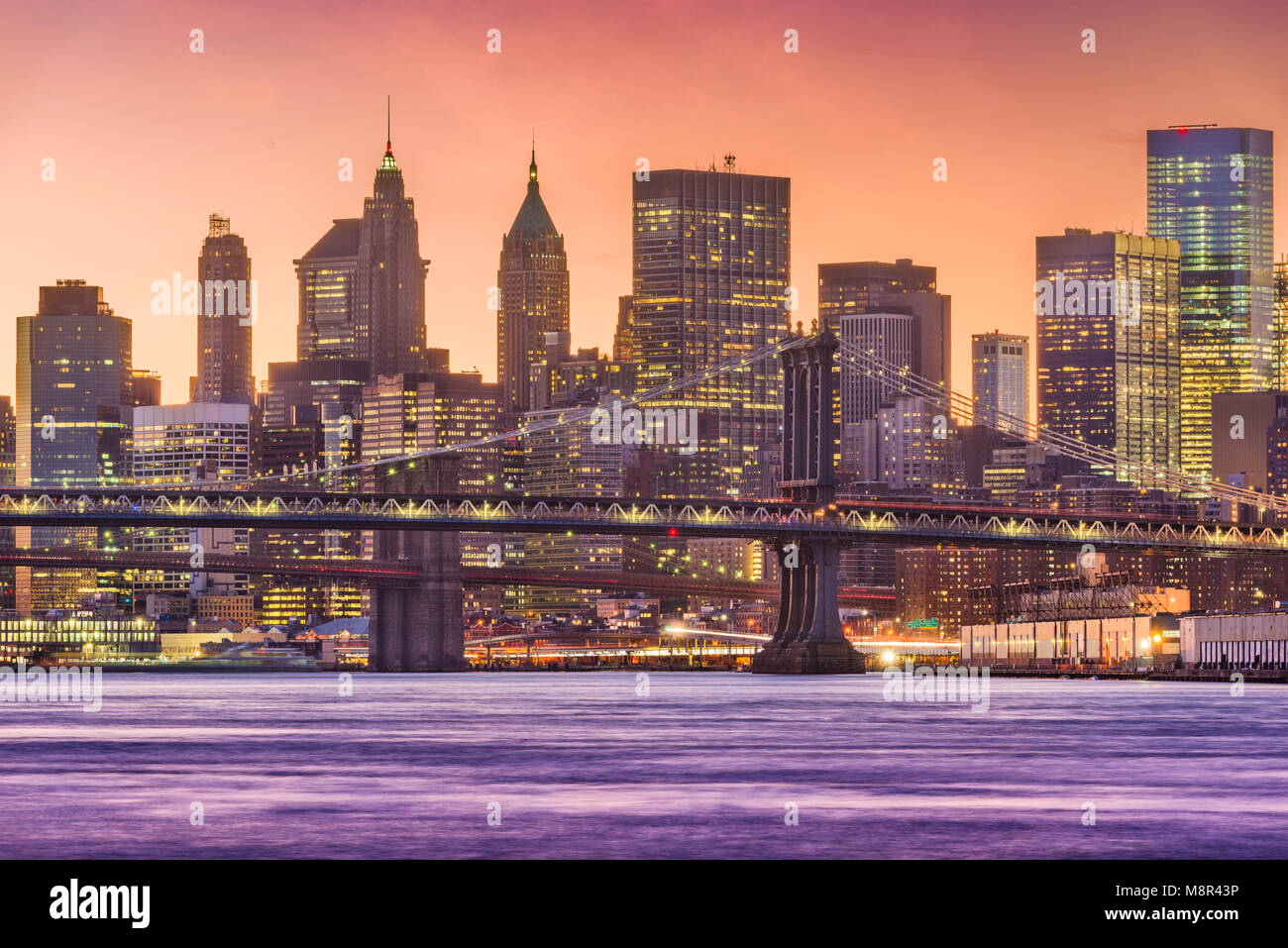 New York, New York, USA lower Manhattan Financial District skyline at dusk on the East River. - Stock Image