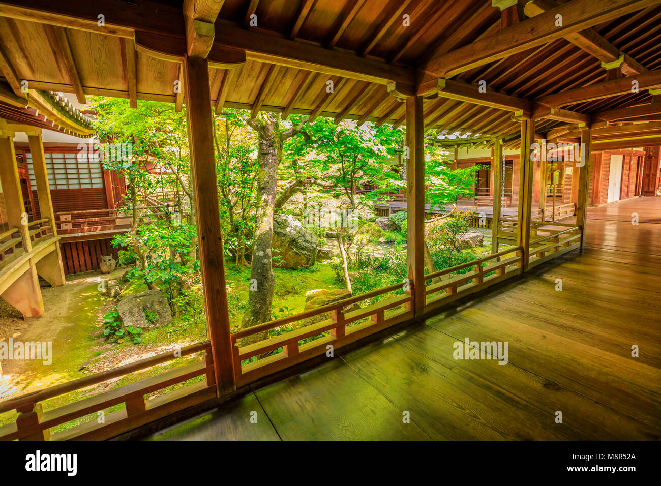 Kyoto, Japan - April 28, 2017: wood footpath corridors connecting buildings of Eikan-do Temple. Zenrin-ji is located - Stock Image