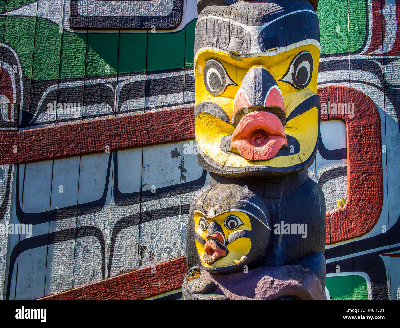 Totem Poles within Thunderbird Park in Victoria, BC,  Vancouver Island next to the Royal British Columbia Museum - Stock Image
