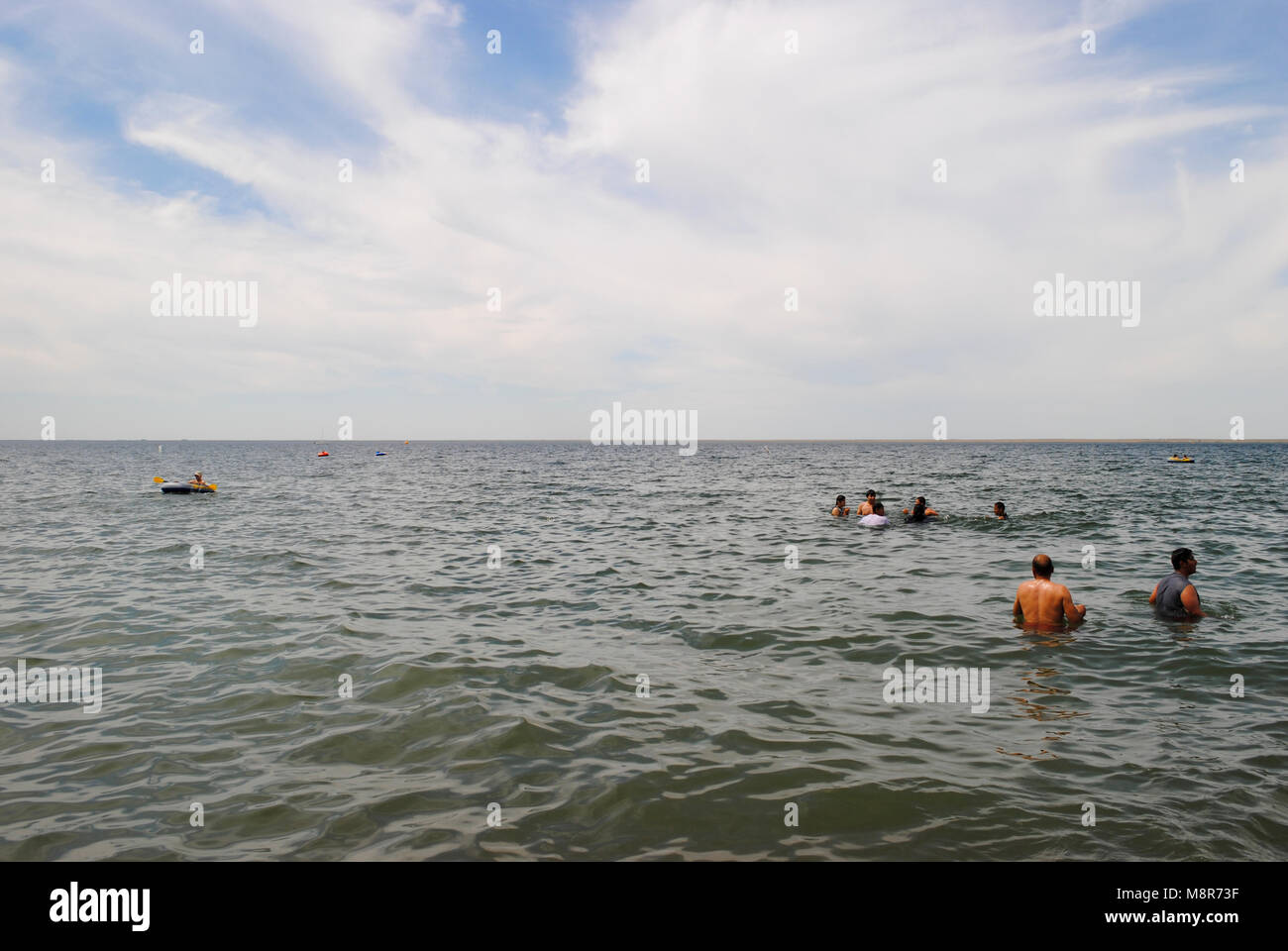 people swimming in the lake - Stock Image
