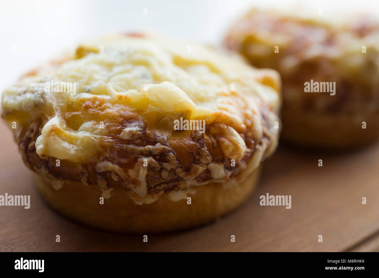 Close-up of fried food served on wooden table - Stock Image