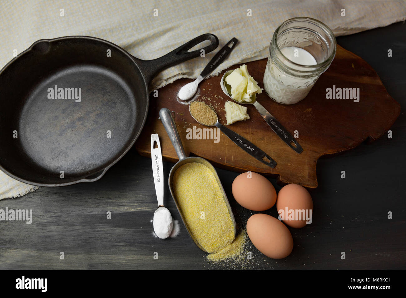 High angle view of kitchen utensils and ingredients on table - Stock Image