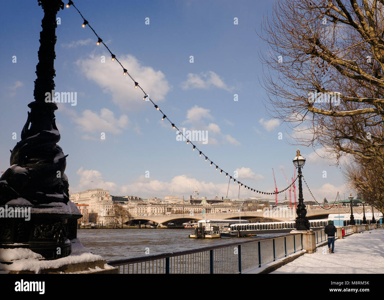The Queens walk' southbank river Thames after snow fall London UK - Stock Image