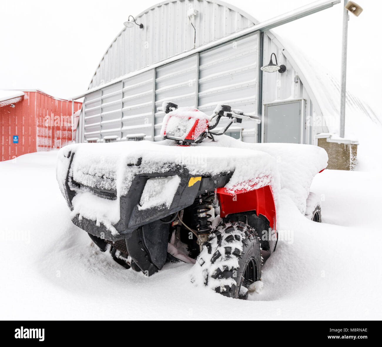 All Terrain Vehicle, 4 Wheeler ATV, in snow, Manitoba, Canada. - Stock Image