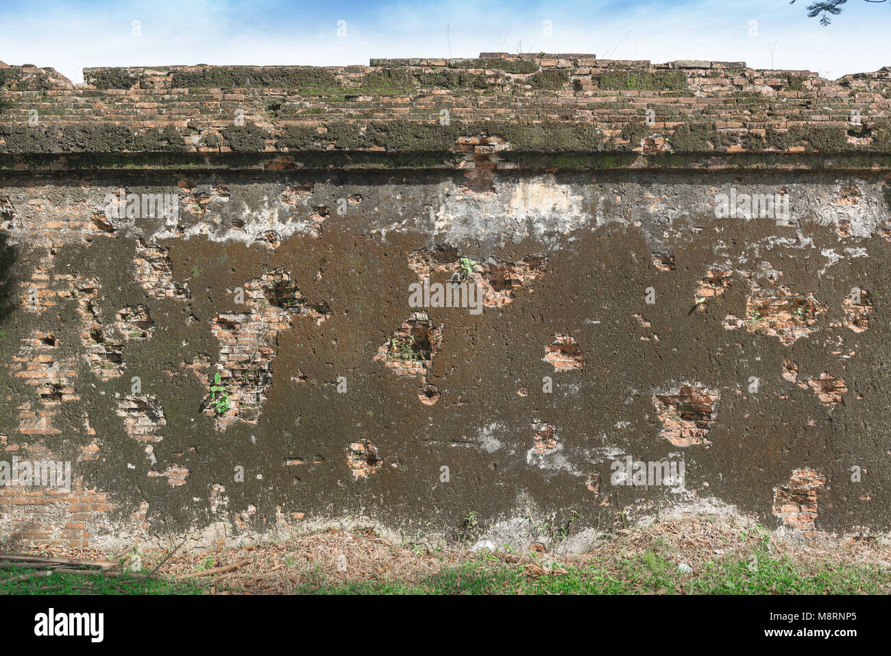 Section of the Citadel wall in Hue still bearing damage and bullet holes from the fierce fighting around the Imperial - Stock Image