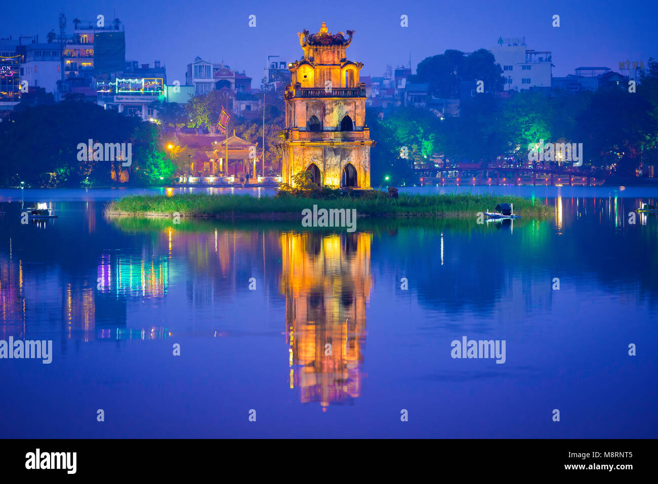 Hanoi lake, view at dusk of the historic pavilion on Hoan Kiem Lake in central Hanoi known as the Tortoise - or - Stock Image
