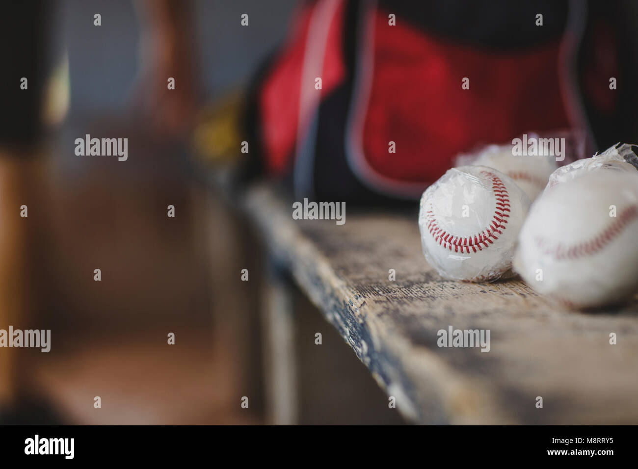 Close-up of baseball balls on table in sports dugout - Stock Image