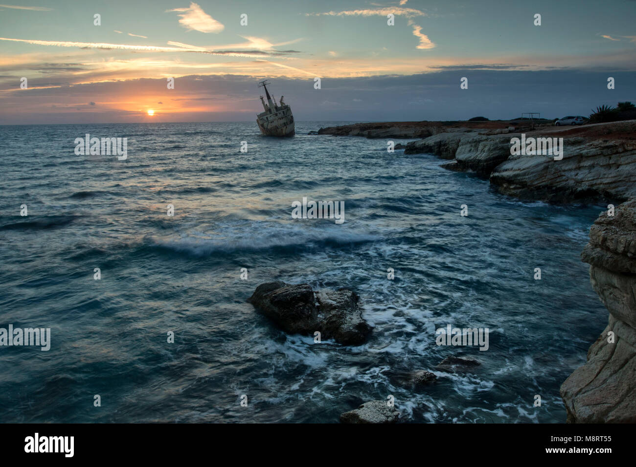Sunset over the Edro 3  on the mediterranean coast of Pegeia, Paphos, Cyprus - Stock Image