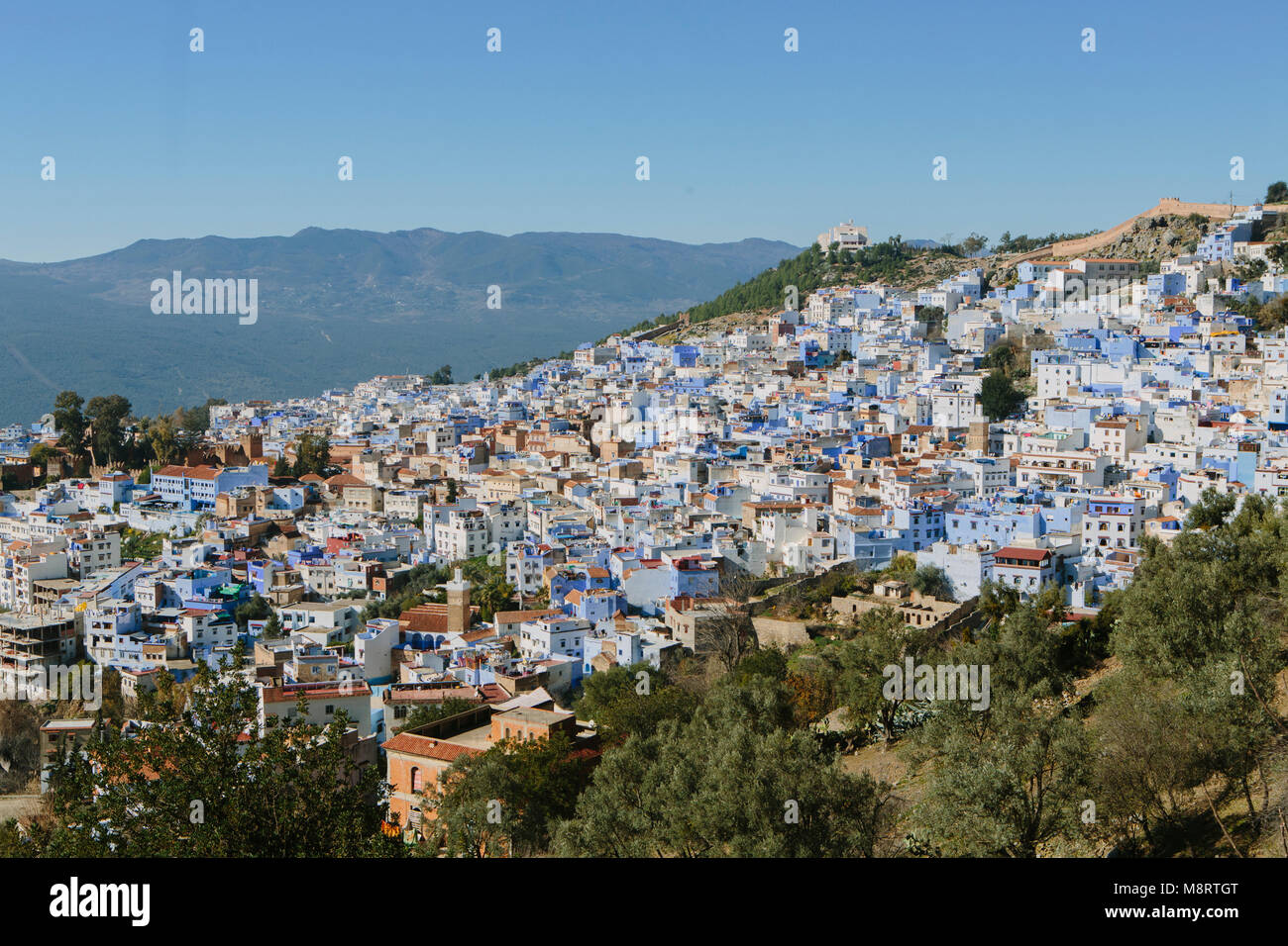 High angle view of buildings on mountain against clear blue sky - Stock Image