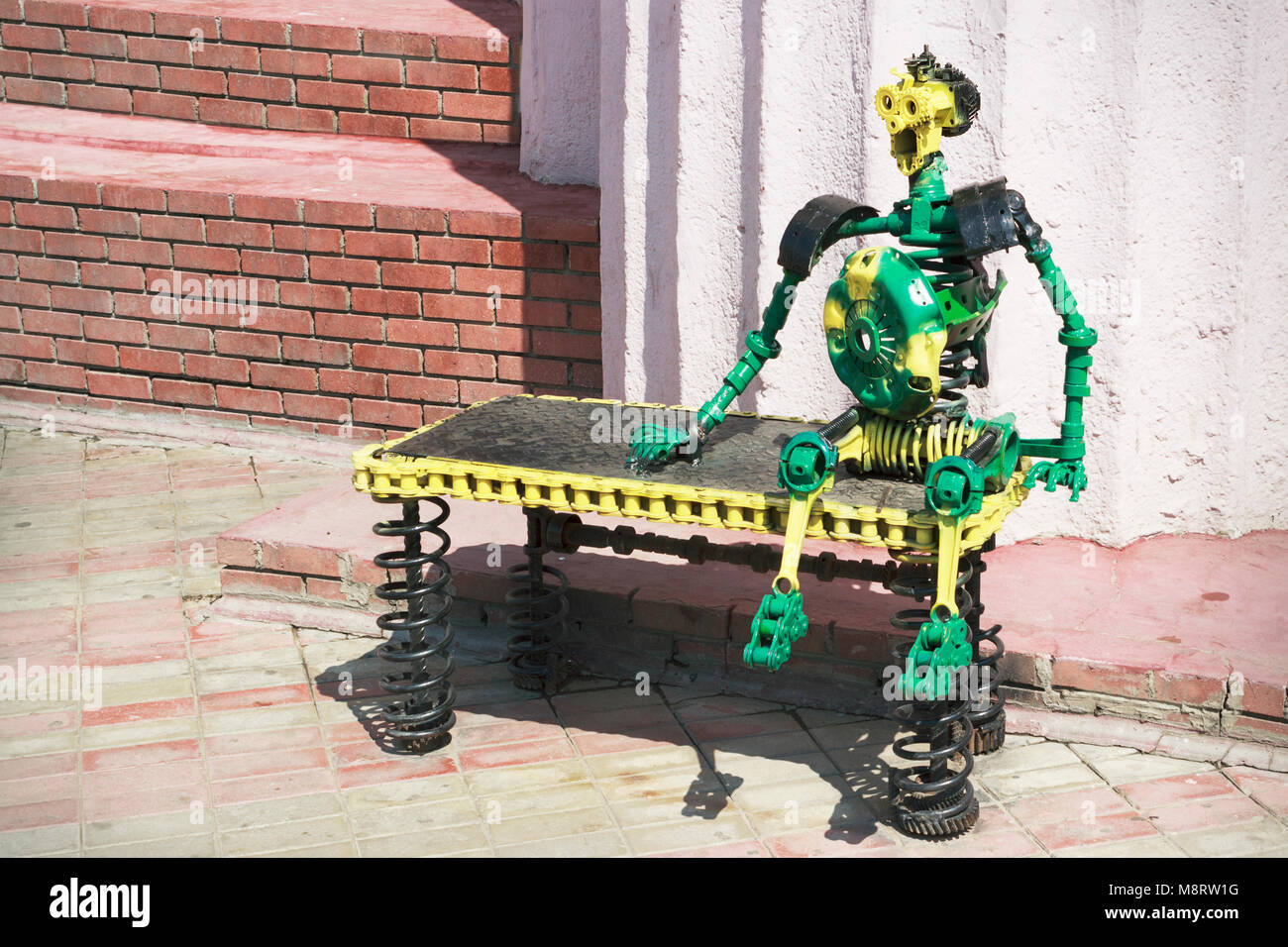 The figure of a man made out of car parts Stock Photo