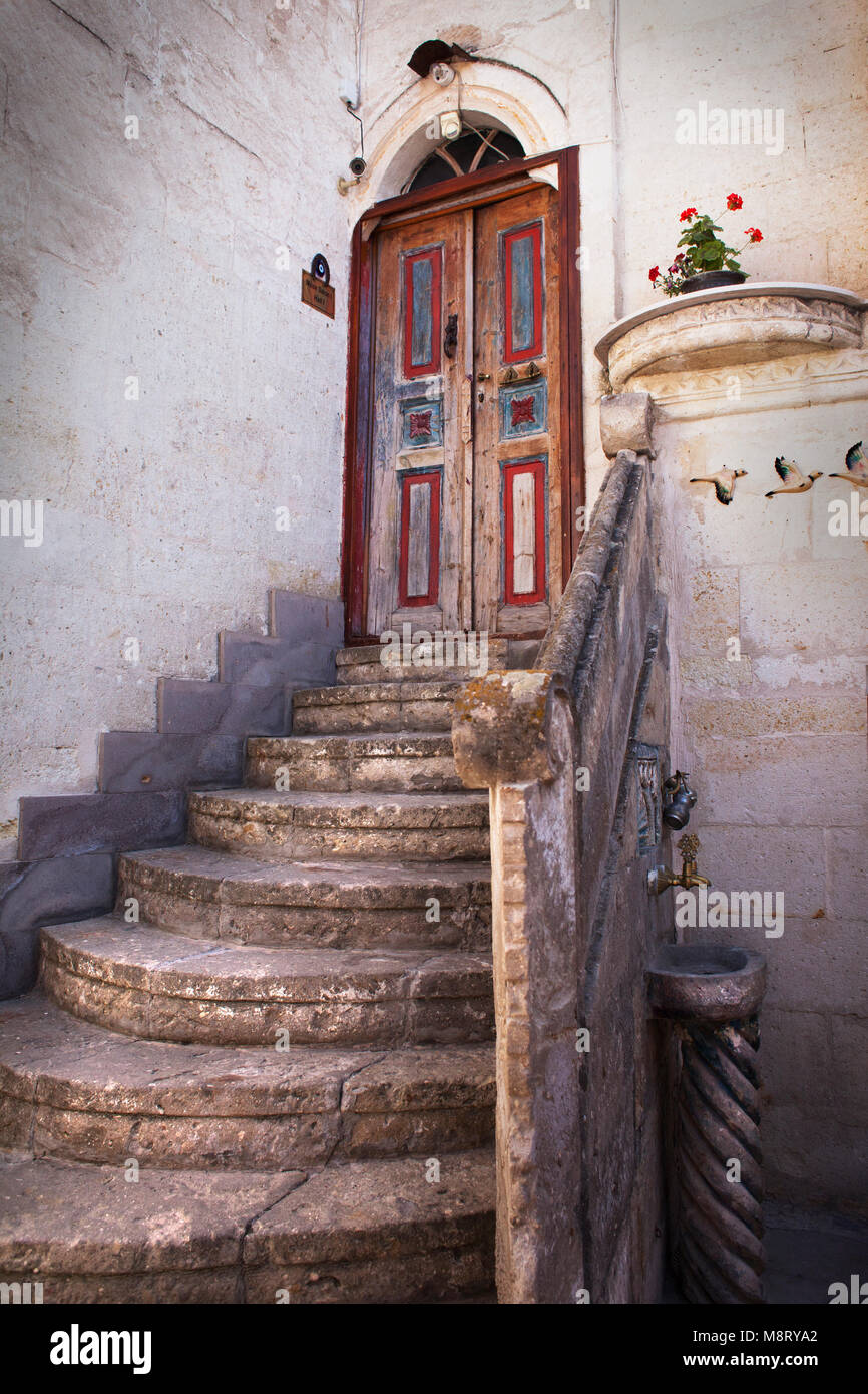 Steps leading to closed doors of historical building - Stock Image