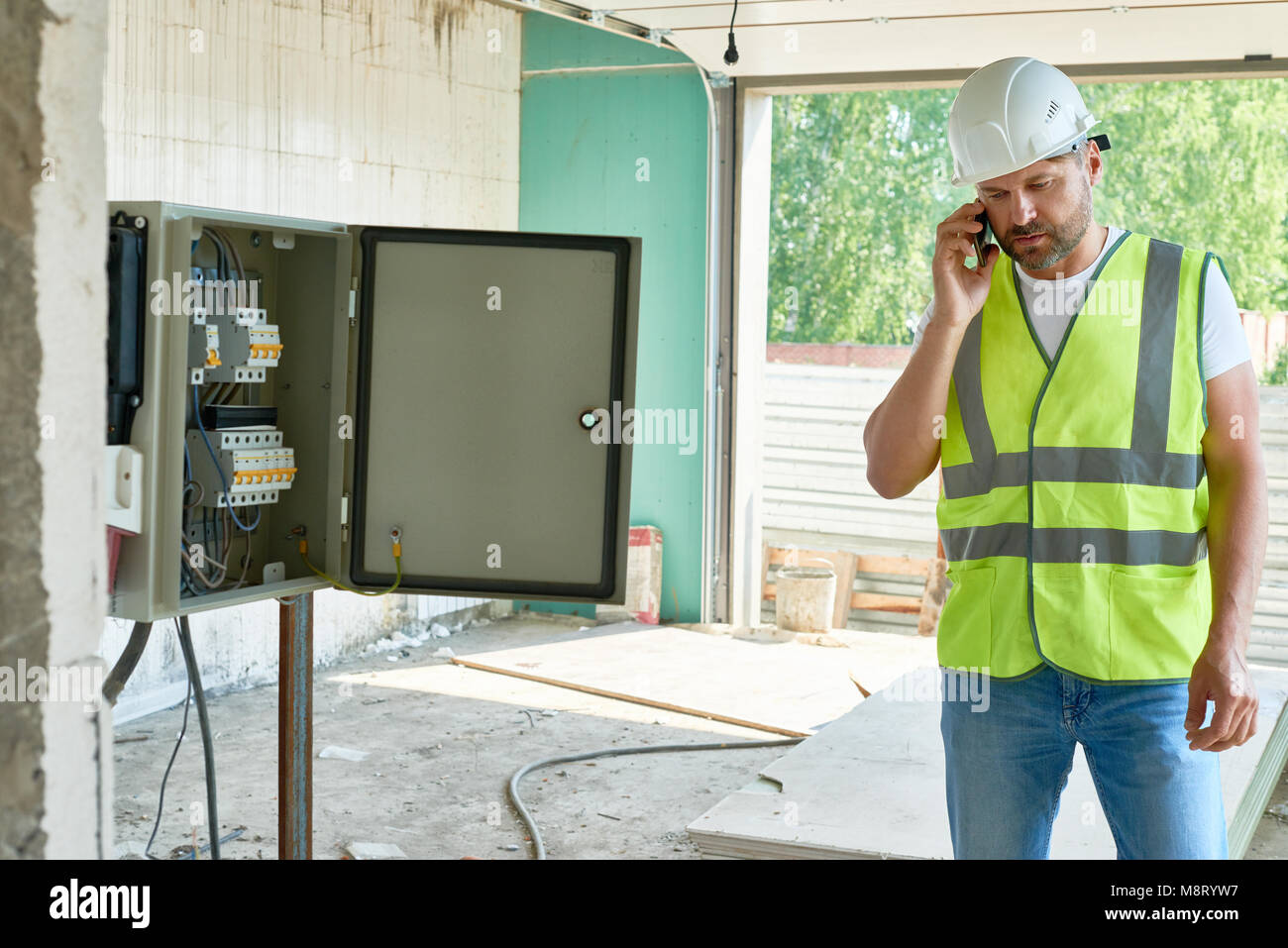 Construction Foreman Speaking by Phone - Stock Image