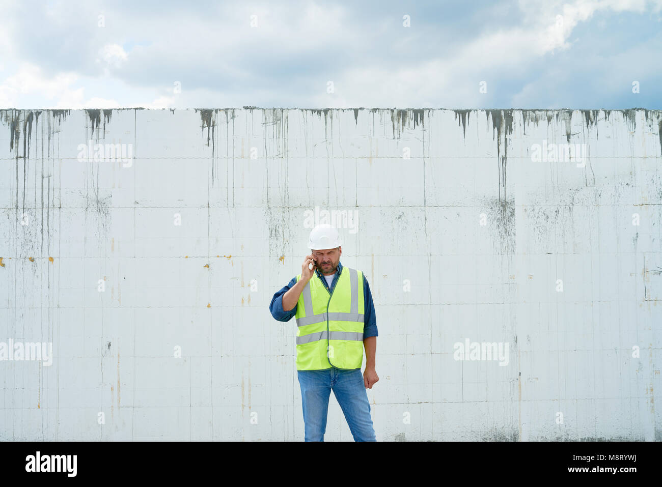 Construction Foreman Calling by Phone - Stock Image