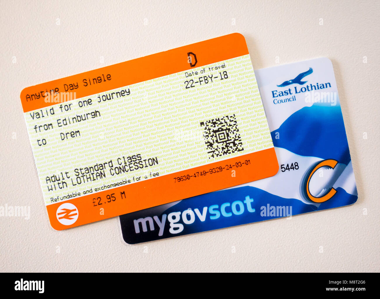 Scottish National Entitlement Card; concession card for free bus travel for over 60s and ScotRail train ticket for - Stock Image