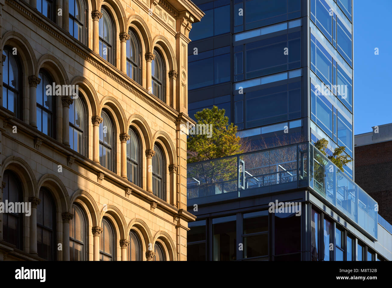 Soho building facades with contrasting architectural styles. New York City, Manhattan, Soho - Stock Image