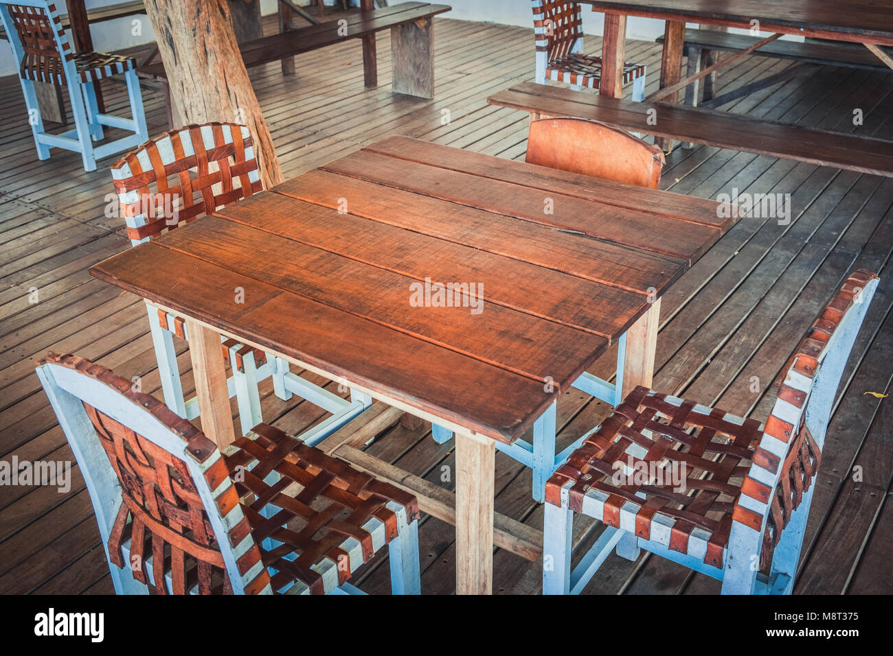 wooden table and four chairs - empty restaurant  - - Stock Image