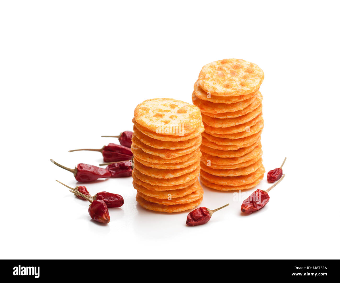 Round  shape rice cracker with chili pepper isolated on white Stock Photo