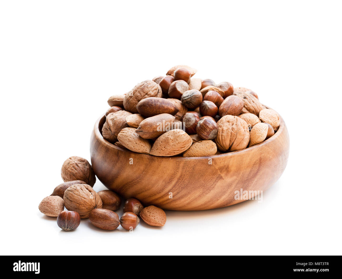 Various  nuts in wooden bowl isolated on white - Stock Image