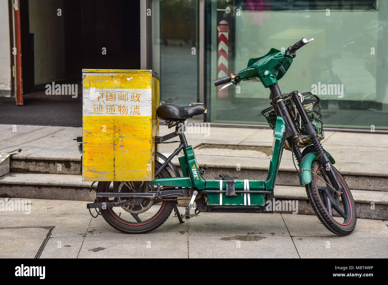 An old green scooter with a wooden storage box on back. A delivery bike in & Delivery Scooter Stock Photos u0026 Delivery Scooter Stock Images - Alamy