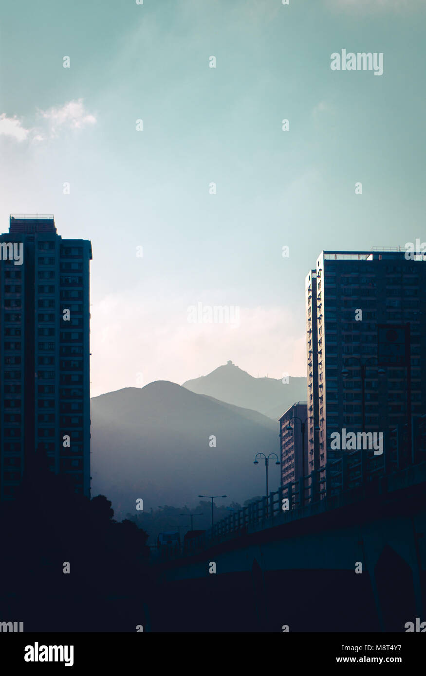 Buildings beside the Shing Mun River in the sunrise - Stock Image