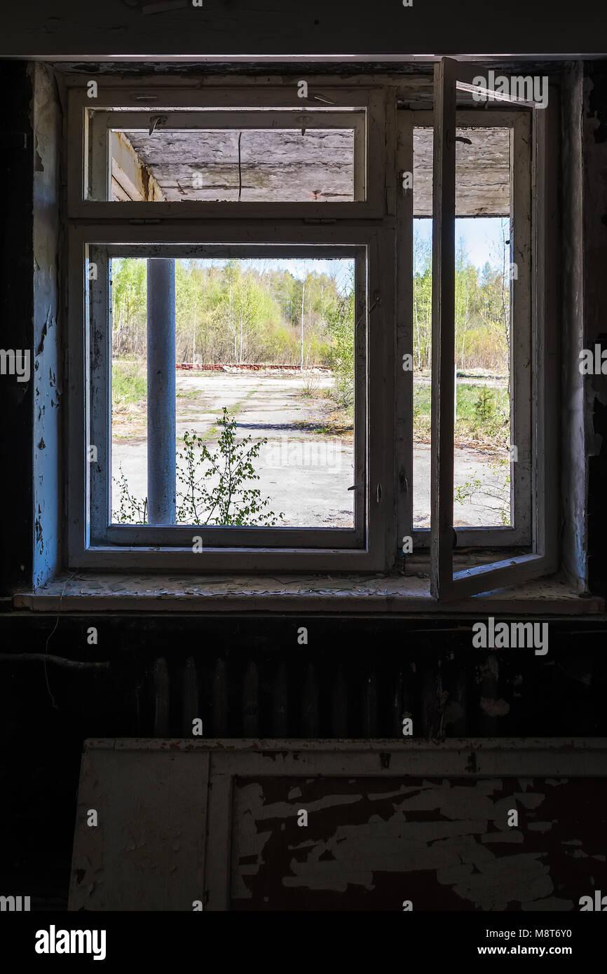 Broken window in one of the abandoned buildings in Skrunda 1. - Stock Image