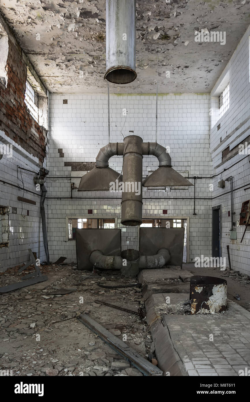 Old kitchen hoods in abandoned industrial kitchen - Stock Image