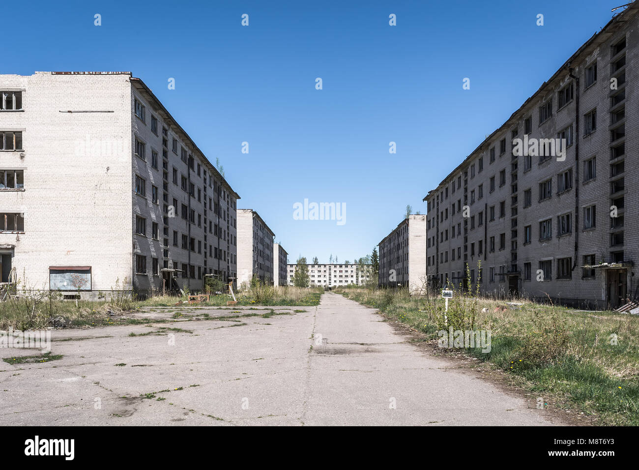 Desolate soviet apartment blocks in Skrunda, Latvia. Former dormitory district in the soviet military base in Skrunda - Stock Image