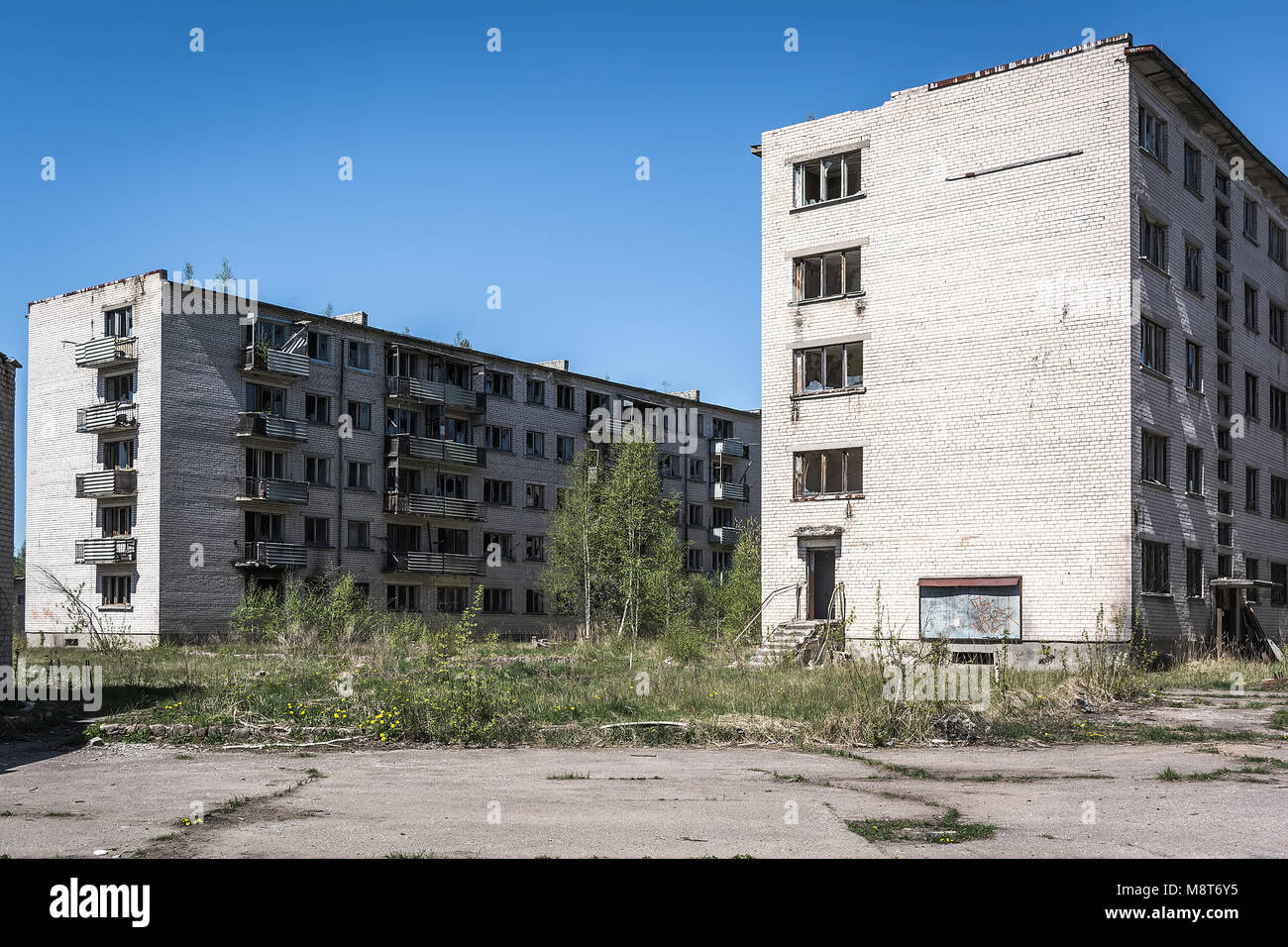 Deserted soviet apartment blocks in Skrunda, Latvia. Former dormitory district in the soviet military base in Skrunda - Stock Image