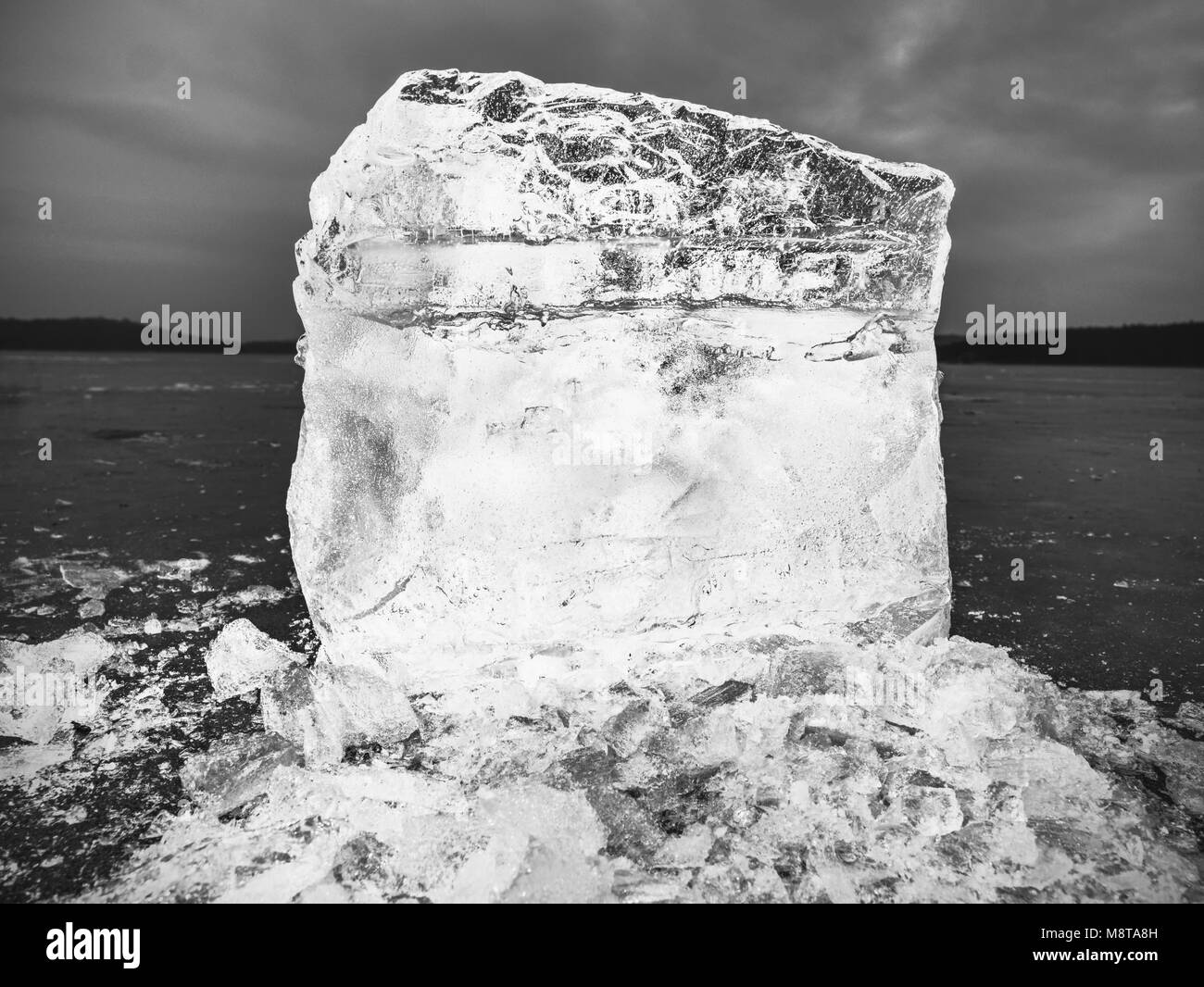 Natural ice blocks. Ice floe breaking due to strong wind against the shore and move. Freezing winter weather. - Stock Image