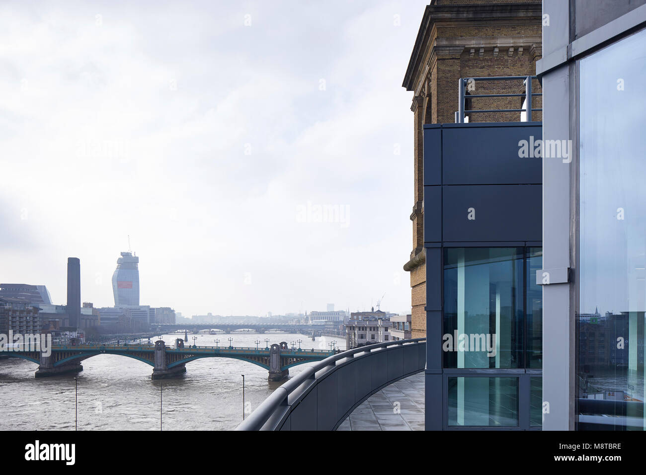 Exterior view towards Southwark Bridge with One Blackfriars in the background. The River Building, London, United - Stock Image